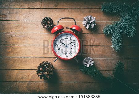 Red Christmas Alarm Clock And Pine Cones