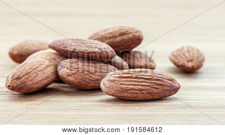 almond seed a healthy food on vintage wooden table