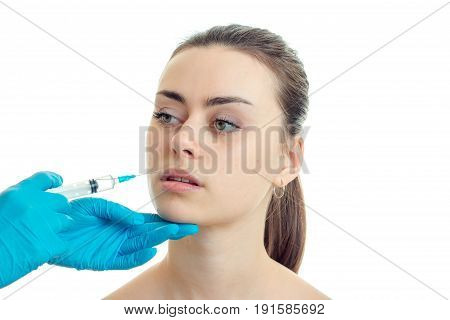 close-up portrait of a young girl with a clean skin which doctor does prick on her face isolated on white background
