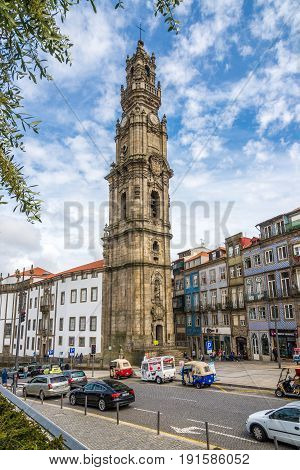 PORTO,PORTUGAL - MAY 13,2017 - Tower bell Clerigos in the street of Porto. Porto is one of the oldest European centers and its historical core was proclaimed a World Heritage Site by UNESCO in 1996.