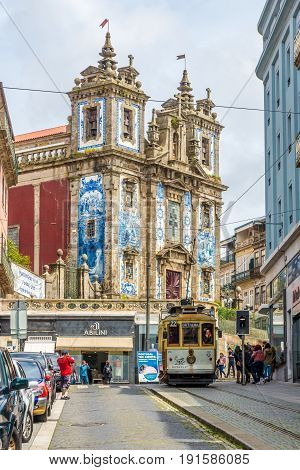PORTO,PORTUGAL - MAY 13,2017 - In the streets of Porto near church of Saint Ildefonso. Porto is located along the Douro river estuary in Northern Portugal.