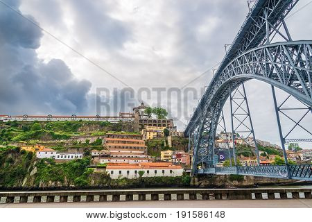 PORTO,PORTUGAL - MAY 13,2017 - View at the Monastery Serra do Pilar and bridge Luis I. in Porto. Porto is located along the Douro river estuary in Northern Portugal.