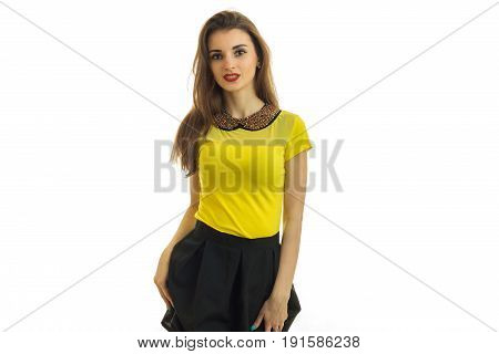 beautiful slender girl in a bright dress posing in Studio isolated on white background