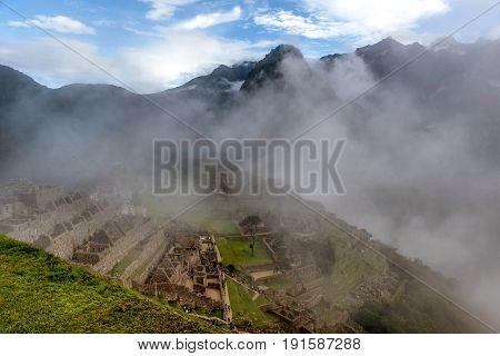 Morning mist rising above Macchu Pichu Valley Peru