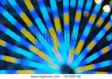 Blur texture of colorful ferry wheel lights in horizontal frame
