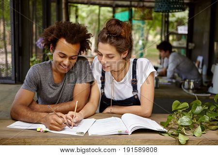 International Friends: African Guy With Curly Hair And Attractive Woman With Dark Hair Tied In Knot