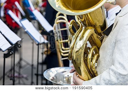 Orchestra Musician Playing Big Brass Tuba During Orchestra Fest