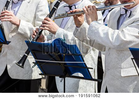 Musicians Playing Flute And Clarinets During Street Concert