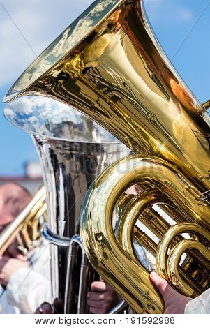 Big Bass Tuba During Open Air Concert Against Blue Sky Background