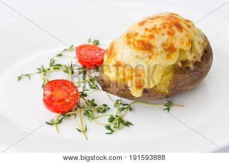 Jacket baked potato -ham and cheese macro close up at restaurant
