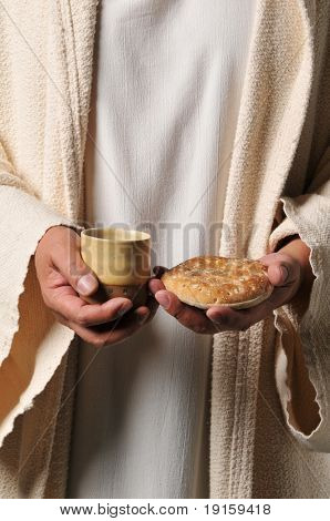 Jesus holding a bread and a wine as a symbol of communion