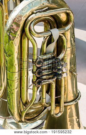 Old Brass Tuba Mechanism. Worn Valves Bass Tuba.