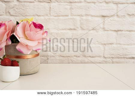 Pink Roses Mock Up. Styled Photography. Brick Wall Product Display. Strawberries On White Desk. Vase