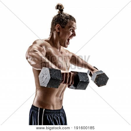 Muscular bodybuilder exercising with dumbbells. Topless young man working out with heavy dumbbells on white background. Side view