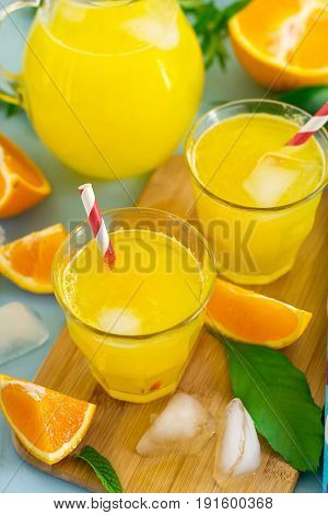Fresh sweet orange drink with ice cubes