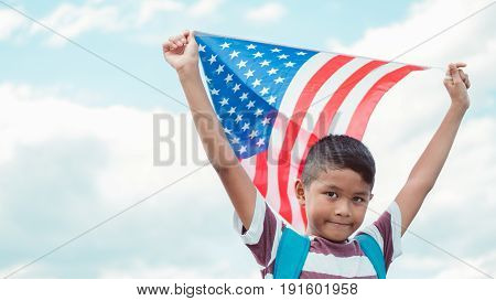 young Asian child with an American flag