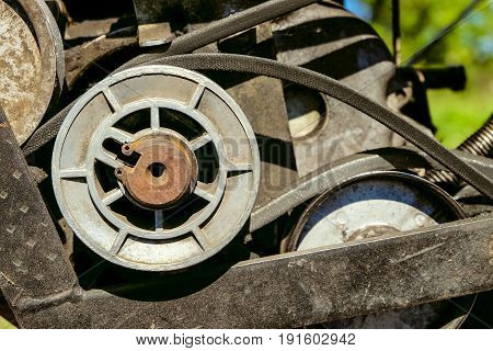 Pulley with belt drive of agricultural motorized machine. Agrimotor detail.