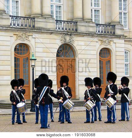 COPENHAGEN, DENMARK - APRIL 22, 2017 : Royal guardsmen in square of Royal castle Amalienborg, Copenhagen, Denmark.