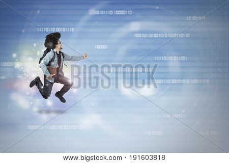 University student running inside binary code while holding book concept of fast internet connection