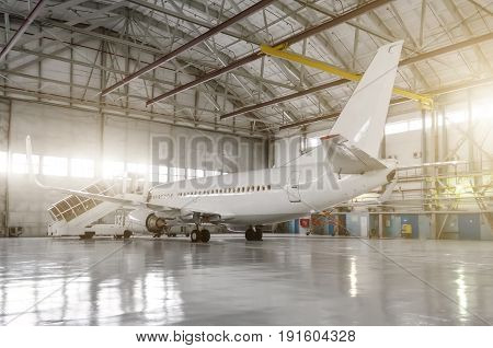 The Airplane In The Hangar, Behind The Whole Plane And The Gangway.