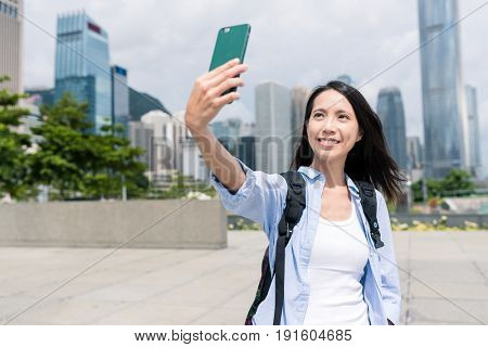 Woman take selfie with mobile phone in Hong Kong