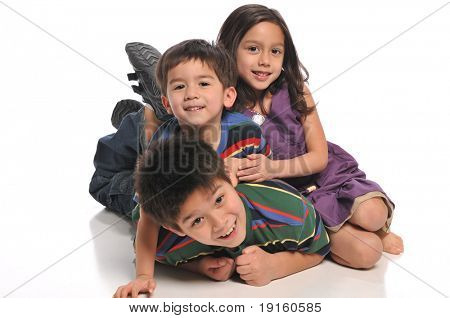 Children playing and having fun isolated on a white background