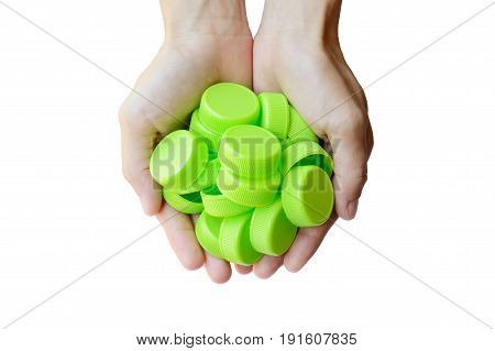 woman hand holding green plastic bottle cap isolated on white background