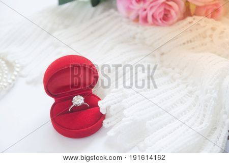 Wedding ring Diamond ring in red box. Selective focus with copy space