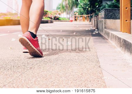 Sport Walking man in the park Healthy lifestyle concept