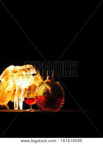 Cognac With A Fire On A Black Background