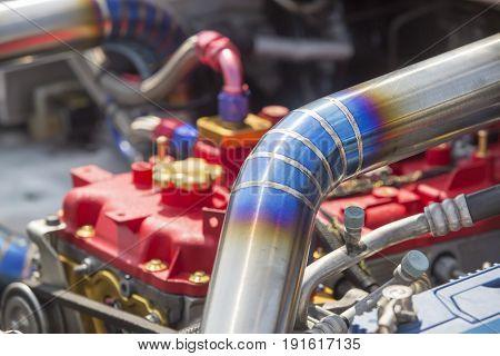 Tig welded seam on stainless steel pipe in racing car.