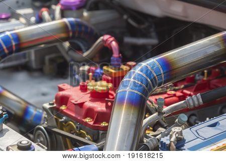 Mig welded seam on stainless steel pipe in racing car .