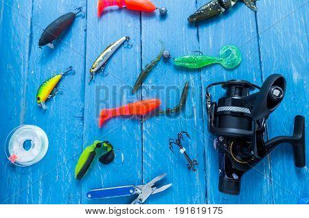 Fishing Reel, Fishing Line, Pliers. Fishing Lures.