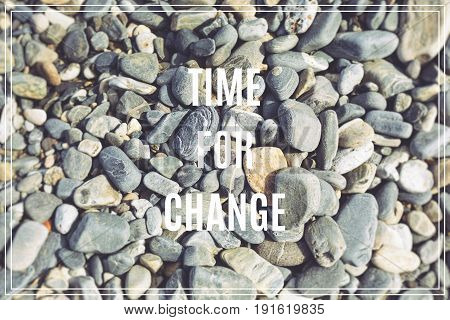 Word Time for Change.Sea stones as background.