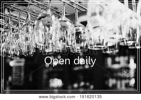 Open Daily. Empty Glasses For Wine Above A Bar Rack.