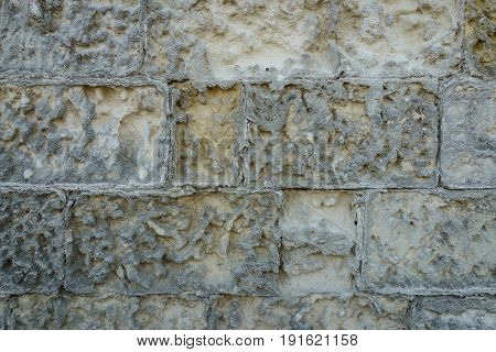 ancient aged stone tiled texture as wall with copy space.