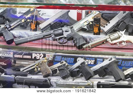 ISTANBUL, TURKEY - 4 APRIL 2017: Showcase of a gun shop in Istanbul at a weapons store on the Galata Bridge.