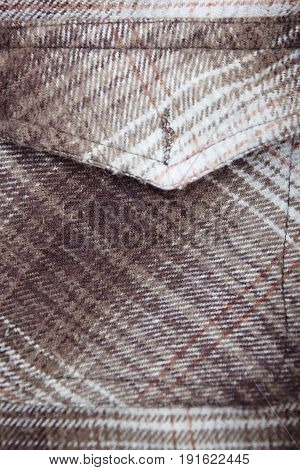 Pocket of woolen shirt. Close-up color photo