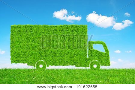 Green Truck in grass. Concept of ecology transport.