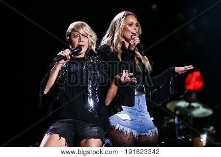 NASHVILLE, TN - JUNE 08: Miranda Lambert (R) and Gwen Sebastian perform at Nissan Stadium during the 2017 CMA Festival on June 8, 2017 in Nashville, Tennessee.