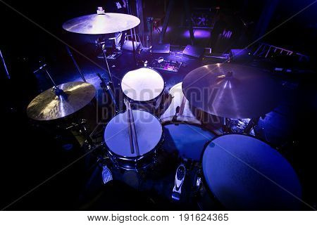 Drums and cymbals on stage before concert.