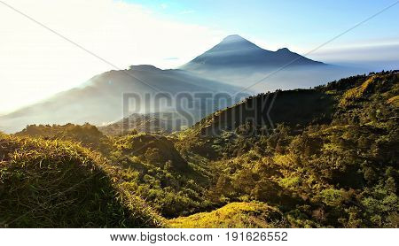 Beautiful morning view at the top of Sikunir Highland. It is located at Dieng, Central Java, Indonesia.