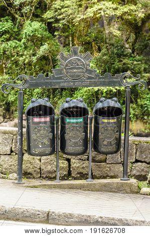 Funny shaped recycling garbage bins in Aguas calientes, Cusco, Peru