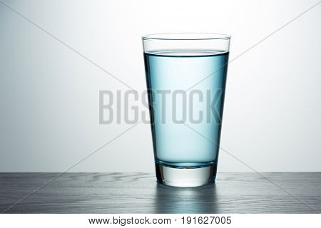 Glass of fresh blue water