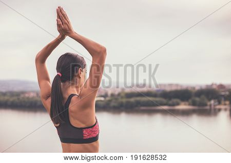 Photo of sporty woman meditating and relaxing outdoor.