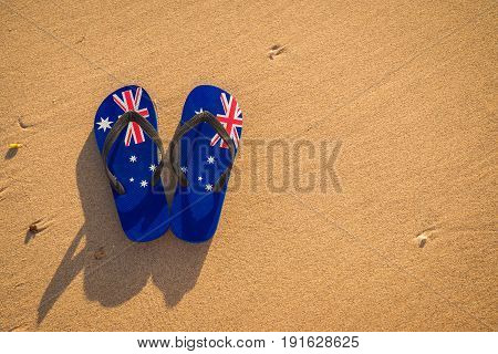 Thongs with Australian flag on the beach at sunset