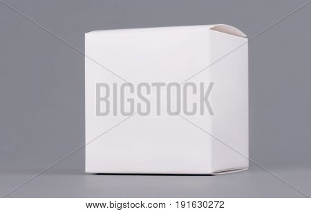 Square white carton product box mock up, side view, clipping path. Clean white cardboard blank mock up. Simple closed package template isolated.