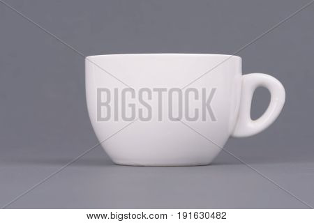 White coffee or tea cup on grey background. Design template for Mock Up. Photo