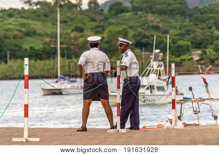 Hell-Ville Madagascar - December 19 2015: Malagasy Police officers are talking at Hell-Ville port Nosy Be Island Madagascar.