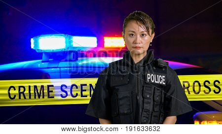 Asian American Policewoman Smiling At Camera